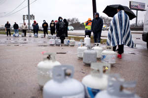 People wait with propane tanks for fresh supplies in Houston on Feb. 17, 2021.