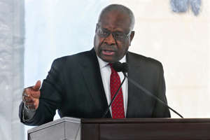 Clarence Thomas wearing a suit and tie: Supreme Court Justice Clarence Thomas delivers a keynote speech during a dedication of Georgia new Nathan Deal Judicial Center Tuesday, Feb. 11, 2020, in Atlanta. The center is named for a former governor and is the first state building in the history of Georgia that is devoted entirely to the judiciary. (AP Photo/John Amis) ORG XMIT: GAJA102