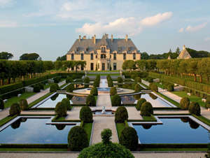 a castle on a hill with Vaux-le-Vicomte in the background: oheka castle in huntington, long island, new york, a wedding and events venue with its own hotel and restaurants