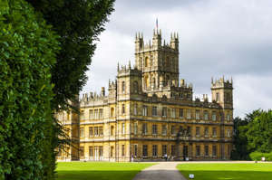 a large clock tower towering over Highclere Castle: gettyimages-1223987599