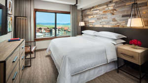 a bedroom with a large bed in a room: Sheraton Steamboat Resort Villas. (Photo courtesy of the hotel)