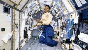 Mae Jemison standing in front of a building