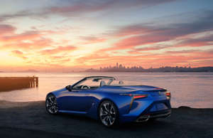 a blue car parked in front of a body of water: This sleek compact convertible is quick (thanks to a V8 engine making 471 hp), stylish, well-balanced to compensate for its lack of a roof, with a stunningly detailed interior and a fantastic soundtrack provided by that V8 (Motor Trend describes it as a