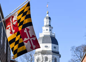 a clock tower in front of a building: The Maryland State House.