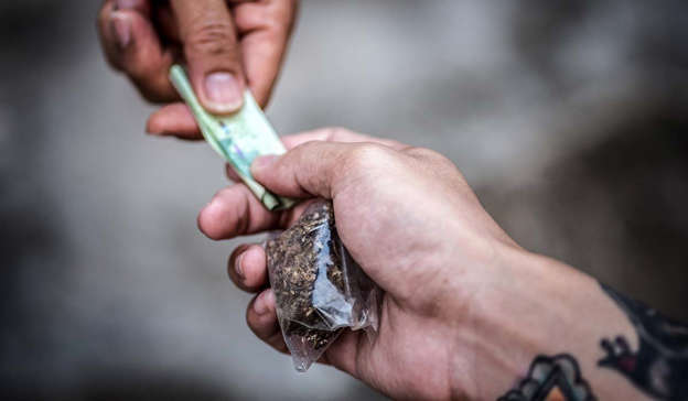 a close up of a hand: The wider scope of the report looks into how violence seen in the EU is often linked to important transit points and is spilling out of major transportation hubs and onto the streets of surrounding cities, where competition for drug distribution takes place. Pic: Getty Images