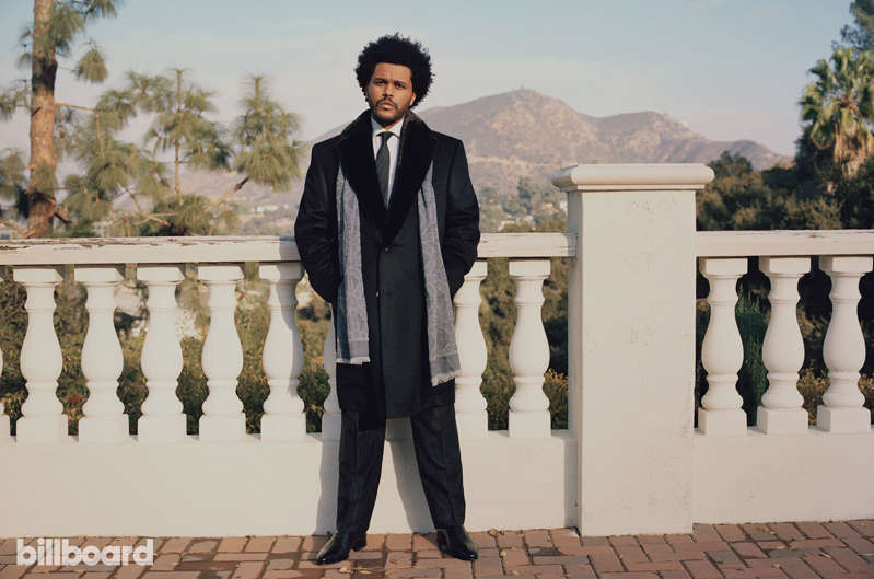 a statue of The Weeknd in a suit and tie: The weeknd abel tesfaye