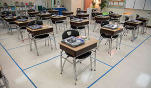 a room filled with furniture and a table: A fourth grade classroom awaits students at Tom Joy Elementary School Monday, Feb. 1, 2021 in Nashville, Tenn. Students are scheduled to phase-in for returning to in-person learning in Metro Schools beginning Feb. 4.