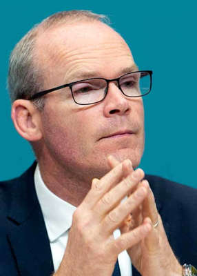 """Simon Coveney wearing glasses: Mr Coveney says that he was """"completely honest"""" with members of the committee about his interactions with Mr Varadkar.. Pic: Sam Boal/Rollingnews.ie"""