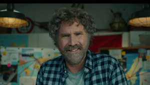 Will Ferrell sitting at a table: Will Ferrell explains why he hates Norway and why General Motors is all about EVerbody In.  https://www.gm-trucks.com/watch-gms-will-ferrell-super-bowl-commercial-here/ and https://www.gm-trucks.com/super-bowl-commercial-preview-gm-teams-up-with-will-ferrell-to-hate-on-norway/