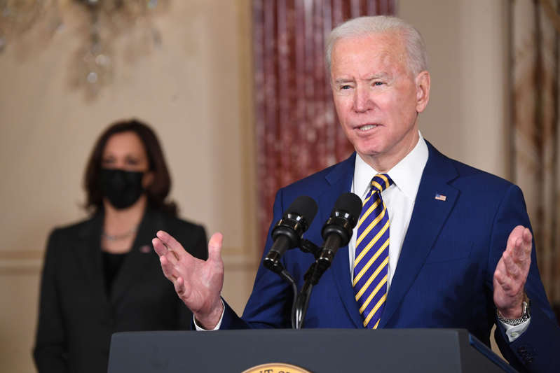 US President Joe Biden, with US Vice President Kamala Harris (L), speaks about foreign policy at the State Department in Washington, DC, on February 4, 2021. - Biden said the US will confront 'authoritarianism' of China and Russia. (Photo by SAUL LOEB / AFP) (Photo by SAUL LOEB/AFP via Getty Images)