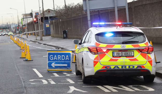 a police car parked in a parking lot: Cllr Flynn was called to the scene where Gardai were already in attendace of a fatal stabbing incident that occurred on East Wall Road, Dublin. Photograph: Leah Farrell / RollingNews.ie