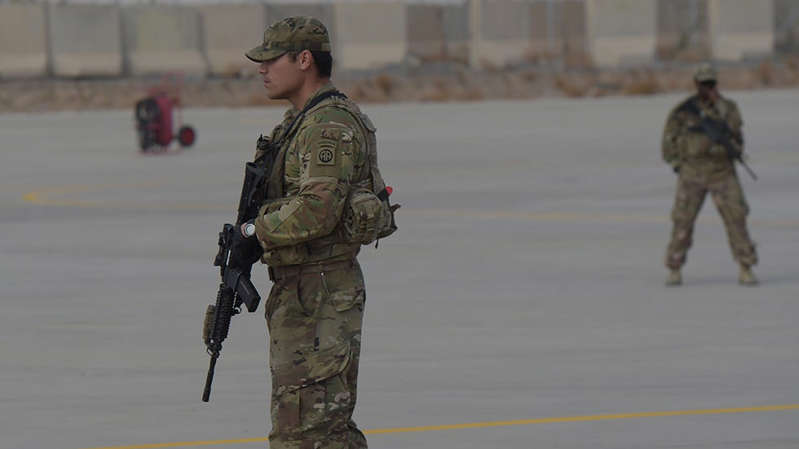 a group of people in uniform: Does US withdrawal from Afghanistan really put the world at risk?