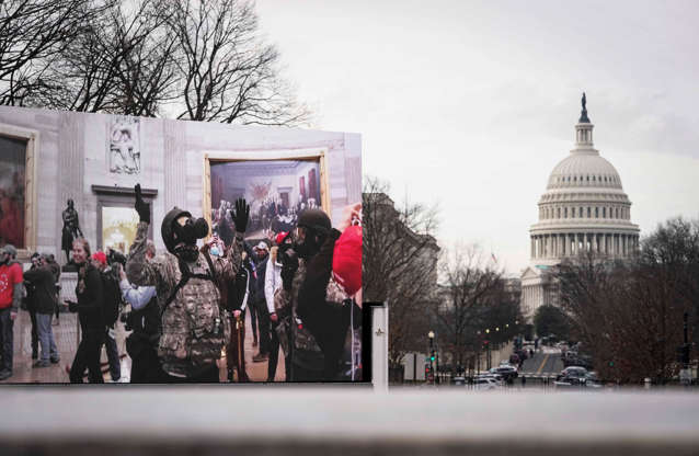 Slide 4 of 35: A video projection near Union Station in Washington, DC displays scenes from the Jan. 6 Capitol Hill insurrection on the first day of the second impeachment trial of former President Donald Trump on Feb. 9, 2021.