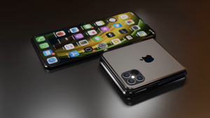 a computer sitting on top of a table: Foldable iPhone Rumors