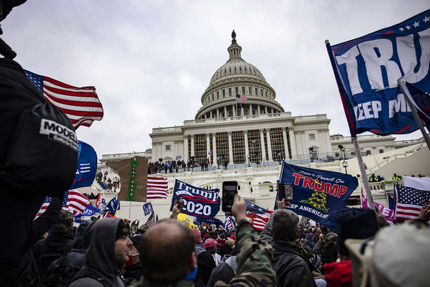 a group of people standing in front of a building: Pro-Trump supporters storm the Capitol following a rally with President Donald Trump on Jan. 6.