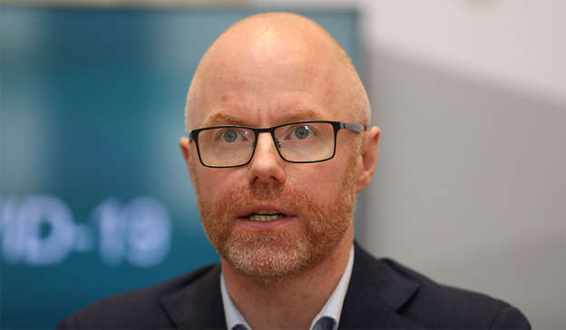 Stephen Donnelly wearing glasses and looking at the camera: The Government's hotel quarantine policy is causing serious division in the Cabinet, with ministers Stephen Donnelly and Simon Coveney said to be at loggerheads. Pic: Leah Farrell/RollingNews.ie