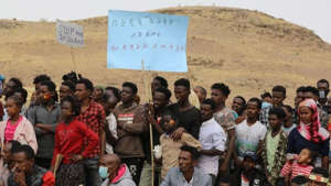 Marquese Scott et al. standing in front of a crowd posing for the camera: UN warns sexual violence being used as war weapon in Ethiopia's Tigray region