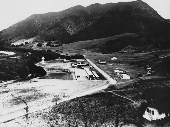 Slide 3 of 41: Universal Studios Hollywood first opened on March 15, 1915, when Carl Laemmle invited thousands to his 230-acre property. Shown here is the backlot of the now-famous production company.