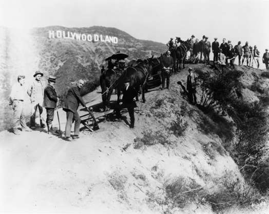 Slide 4 of 41: The Hollywoodland sign was erected just two years before this photo was taken, as a means of encouraging people to live in the suburban housing development with that same name.