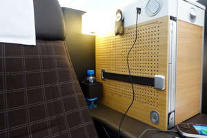 a computer sitting on top of a wooden table: Swiss business class is just one premium partner award readily available with United miles. (Photo by Zach Honig/The Points Guy.)