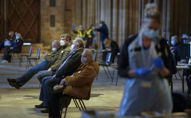 Members of the public receive their Covid-19 vaccinations at Lichfield Cathedral, Staffordshire on February 26, 2021 in Lichfield, England. Lichfield Cathedral is one of many unusual venues that have been adapted for administering vaccines during the Covid-19, coronavirus pandemic. Over 19 million people in the United Kingdom have had their first Covid-19 vaccination, including 90 percent of over-70s.