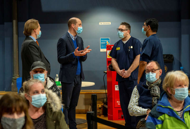 KING'S LYNN, ENGLAND - FEBRUARY 22: Prince William, Duke of Cambridge visits King's Lynn Corn Exchange Vaccination Centre on February 22, 2021 in King's Lynn, England. The Duke spoke to NHS staff and volunteers and heard more about their experiences of being involved in the vaccination programme. (Photo by Arthur Edwards - WPA Pool/Getty Images)