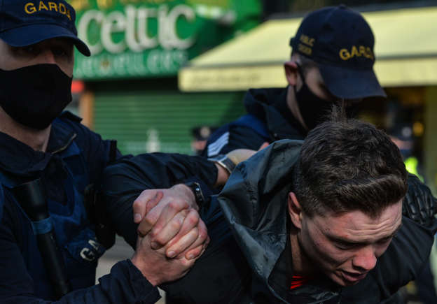 An Anti-Lockdown protester arrested by Gardai during clashes in Grafton Street, Dublin, during Level 5 Covid-19 lockdown. On Saturday, Fabruary 27, 2021, in Dublin, Ireland.