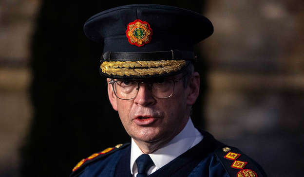 a man wearing a suit and hat: On Thursday, Garda Commissioner Drew Harris apologised to domestic violence victims whose 999 calls were cancelled by Gardai. Pic: Damian Eagers/PA Wire
