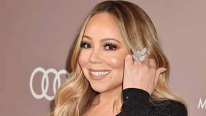 Mariah Carey wearing a blue shirt: After a thriving career in the 90s, with hits like 'Always Be My Baby,' 'Heartbreaker,' and 'Honey,' Mariah Carey released an unsuccessful eighth studio album, 'Glitter.' Four years later, in 2005, the singer released 'The Emancipation of Mimi,' which topped the US charts It became her fifth number-one album and the first since 'Butterfly,' even ultimately earning 10 Grammy nomination and winning three.