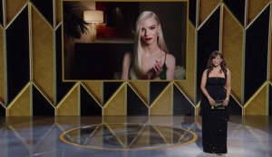 "In this video grab issued Sunday, Feb. 28, 2021, by NBC, Anya Taylor-Joy appears on screen as she accepts the award for best actress in a television motion picture for ""The Queen's Gambit"" as presenter Rosie Perez looks on at the Golden Globe Awards. (NBC via AP)"
