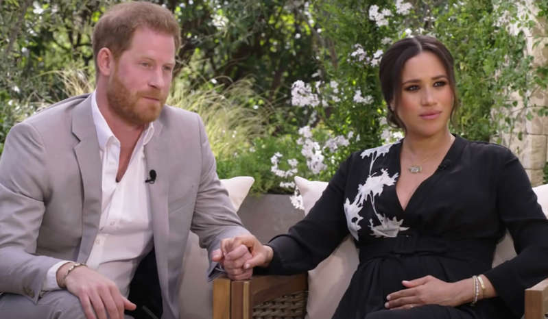Prince Harry, Meghan Markle posing for the camera: Prince Harry and Meghan Markle had reportedly considered the royal who made a comment about their son Archie's skin before he was born. Pic: CBS