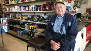 a man standing in front of a store: 94-year-old Rentz man still reports to work every day
