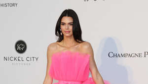 "a woman wearing a pink dress: The model grew up in the limelight of 'Keeping Up with The Kardashians' so for many fans it seems like they know her. But according to her, the real secrets to her personality are written in the stars. She told Allure: ""I'm a Scorpio, so I stick to people. If I love you, I love you. If I don't like you, you're screwed."" Her sisters are also firm believers in astrology and Kim wrote on her website: ""Kylie is a Leo and I'm a Libra, and it turns out these two signs are super complementary and good for each other. Leo is a fire sign, with a strong energy (SO Kylie!), while Libra, an air sign, is way more subtle. Fire needs air to survive, so it's a perfect pair!"""