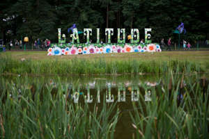 a group of people riding on the back of a pond: Latitude Festival