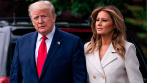 "Donald Trump, Melania Trump are posing for a picture: WASHINGTON, DC - MAY 25: U.S. President Donald Trump and first lady Melania Trump depart the White House for Baltimore, Maryland on May 25, 2020 in Washington, DC. The Trumps will attend a Memorial Day ceremony at the Fort McHenry National Monument and Historic Shrine despite objections by Baltimore Mayor Bernard C. ""Jack"" Young, whose residents remain under a stay-at-home order due to the coronavirus. (Photo by Sarah Silbiger/Getty Images)"