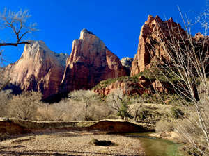 a canyon with a mountain in the background: Getting away from the crowds in Zion. (Photo courtesy of Melanie Haiken)