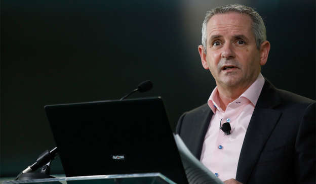 Paul Reid wearing a suit and tie in front of a laptop: HSE CEO Paul Reid is concerned over the latest daily COVID numbers in Ireland. Pic: Leon Farrell/Photocall Ireland