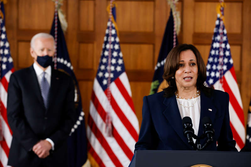 """File: U.S. President Joe Biden and Vice President Kamala Harris deliver remarks after a meeting with Asian-American leaders to discuss """"the ongoing attacks and threats against the community,"""" during a stop at Emory University in Atlanta, Georgia, U.S., March 19, 2021. REUTERS/Carlos Barria"""