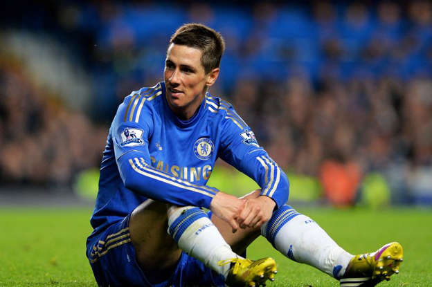 a close up of a football player on a field: Fernando Torres' move to Chelsea remains one of the most expensive mistakes in Premier League history