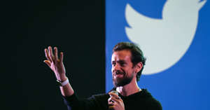 Jack Dorsey holding a microphone: Twitter CEO and co-founder Jack Dorsey gestures while interacting with students at the Indian Institute of Technology (IIT) in New Delhi on November 12, 2018.