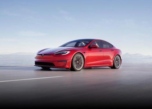 a car driving on a road: Tesla finally gave its Model S sedan a much needed refresh.