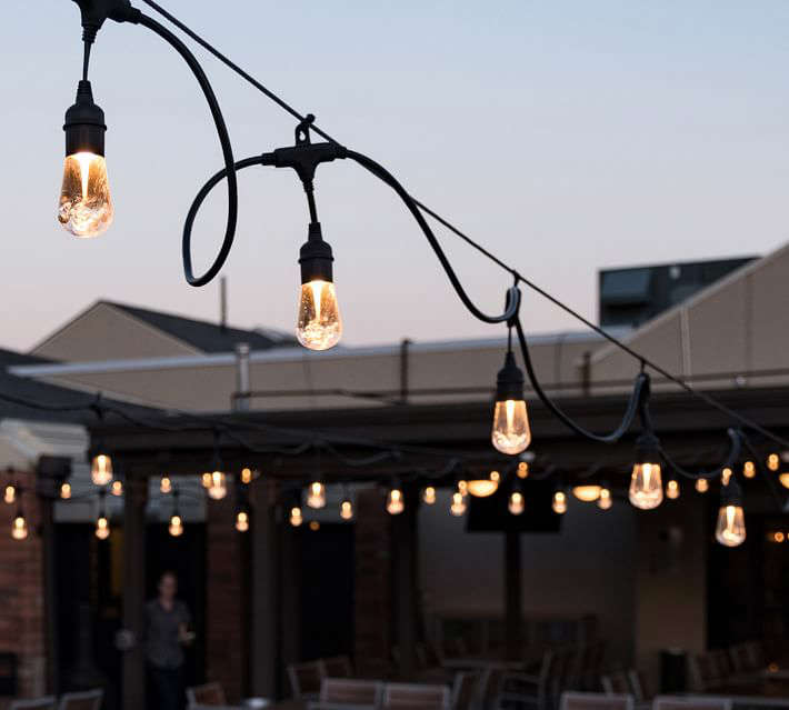 a traffic light hanging off the side of a building: Pottery Barn Indoor/Outdoor LED String Lights - Black