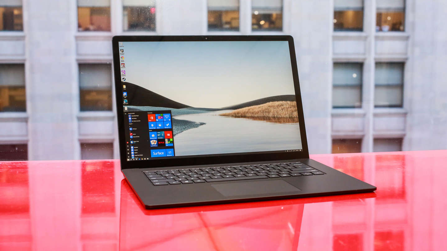 a laptop computer sitting on top of a table: Microsoft's Surface Laptop 3 runs Windows 10.