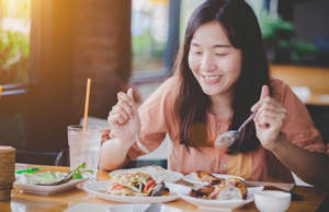 a woman sitting at a table with a plate of food: Do you have a fast metabolism? Briefly, the quicker your metabolic rate is, the quicker your body will burn calories. As you age, however, you may find that your metabolism slows down naturally, which could lead to weight gain. Luckily, there are small and simple ways you can speed it up. Let's take a look at 20 tips you can try straight away.