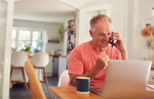 a man sitting at a table looking at a laptop: This story originally appeared on NewRetirement. Early retirement is a dream for many. However, a really early retirement is fairly rare. According to research published on LIMRA, only about 20% of all Americans retire in their 50s or before — with most of those happening after age 55. For those that do retire early, figuring out how to fund expenses can be challenging. One problem is that most of the retirement savings vehicles — namely traditional 401(k)s and IRAs — enforce a 10% penalty for any withdrawals made before age 59.5. However, there are a few ways around the rules. Keep reading for ways to avoid penalties on withdrawals made before you get to age 59.5 (However, it is important to note that just because you can, doesn't mean you should.)  It's not the usual blah, blah, blah. Click here to sign up for our free newsletter. Sponsored: Find the right financial adviser Finding a financial adviser you can trust doesn't have to be hard. A great place to start is with SmartAsset's free financial adviser matching tool, which connects you with up to three qualified financial advisers in five minutes. Each adviser is vetted by SmartAsset and is legally required to act in your best interests. If you're ready to be matched with local advisers who will help you reach your financial goals, get started now.