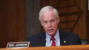 Ron Johnson wearing a suit and tie