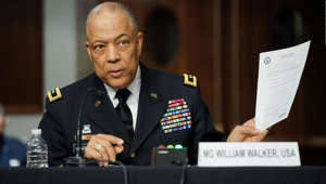 a man wearing a suit and tie: Commanding General District of Columbia National Guard Major General William J. Walker testifies before the Senate Homeland Security and Governmental Affairs/Rules and Administration hearing to examine the January 6, 2021 attack on the US Capitol on Capitol Hill on March 3, 2021 in Washington, DC. (Photo by Greg Nash / POOL / AFP) (Photo by GREG NASH/POOL/AFP via Getty Images)