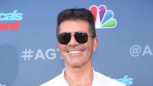 Simon Cowell wearing sunglasses posing for the camera