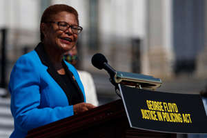 Karen Bass wearing a suit and tie: FILE - In this June 25, 2020, file photo Rep. Karen Bass, D-Calif., speaks during a news conference on the House East Front Steps on Capitol Hill in Washington ahead of the House vote on the George Floyd Justice in Policing Act of 2020. California Congresswoman Bass has emerged a leading contender to be Democrats' vice presidential candidate. Allies say her reputation as a bridge-builder would make her a strong partner to presumptive Democratic presidential nominee. (AP Photo/Carolyn Kaster, File) ORG XMIT: WX202