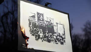 calendar: This is a livestream of the first-ever authenticated Banksy art burning.  Auction on OpenSea starting tomorrow.  Follow the official Burnt Banksy Twitter account for official links to auctions: https://twitter.com/BurntBanksy  ___________  Hi everyone. I am excited to share with you today the first ever burning of an authentic Pest control certified Banksy piece. After the burn, we will mint an original NFT with the help of SuperFarm which is an innovative new platform for accessing and selling NFTs.  An auction for the piece will be held on Open Sea starting tomorrow. The official link for this can be found on our twitter @BurntBanksy  I represent one of the members of a group of art and NFT enthusiasts.   The piece itself is called Morons and it was first created back in 2006.   We see this event encapsulating the first ever major transition of a physical art piece into a digital one.  We view this burning event as an expression of art itself. We are generating a new form of artwork via the creation of this unique NFT that is a direct representation of the physical. The reason the burning itself is so important is because as long as the physical piece exists, the value of that piece will remain with the physical. However, if we entirely re-create the physical piece and input specifications such as the art version number into the smart contract code, no one can ever alter the the digital art in any way. In this way the physical piece will forever be memorialized in this NFT.  We hope to inspire new tech and art enthusiasts with our work. We believe NFTs hold tremendous promise and blockchain technology can help to further diversify art expression as we have demonstrated with this Banksy burning.  Finally, I would again like to thank our friends at SuperFarm and Injective Protocol for their support in organizing this event.